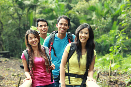 group of people hiking together. walking in the countryside photo