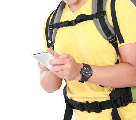 portrait of male hiker hand with backpack using mobile phone isolated on white background photo
