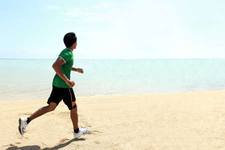 portrait of Man running on the beach photo