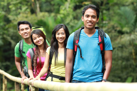 backpackers: group of people hiking together. walking in the countryside Stock Photo