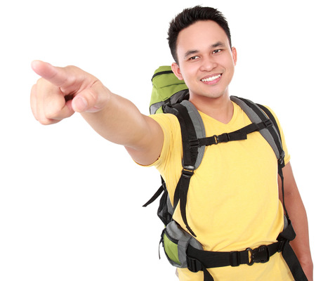 man with backpack pointing to the direction with hand isolated over white background photo