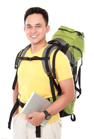 internet explorer: portrait of a smiling male hiker with backpack using tablet computer isolated on white background Stock Photo