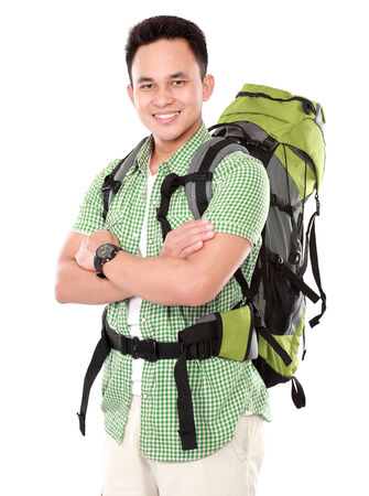 portrait of a smiling male hiker with backpack isolated on white background photo