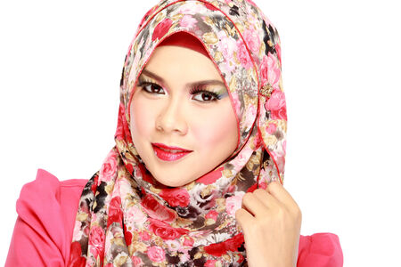 Fashion portrait of young beautiful muslim woman with red scarf isolated on white background photo