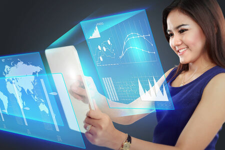 Portrait of Businesswoman pointing to a graph on transparent touchscreen photo