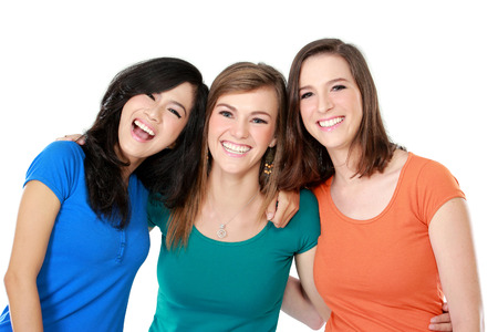 over white: portrait of attractive multi racial three girls best friend together having fun isolated over white background