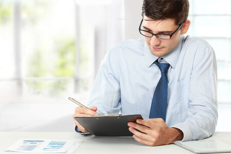 contemplative: Portrait of a young businessman while working in the office Stock Photo