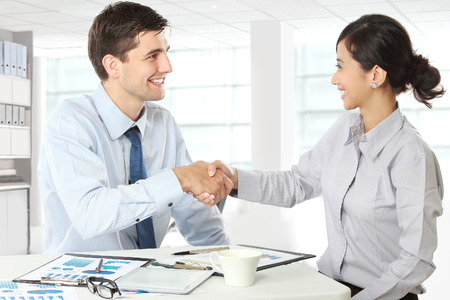 Portrait of Interviewer shaking hand to future employee photo