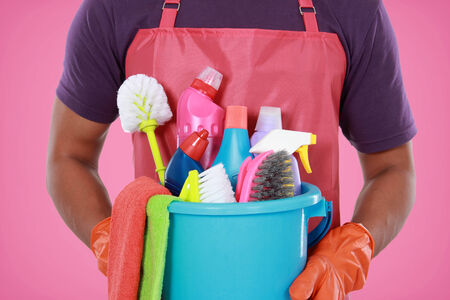 Portrait of hand with cleaning equipment ready to clean house photo