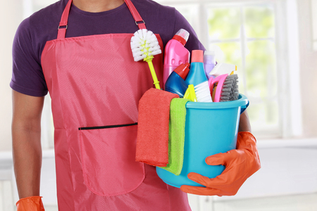 bright housekeeping: Portrait of hand with cleaning equipment ready to clean house