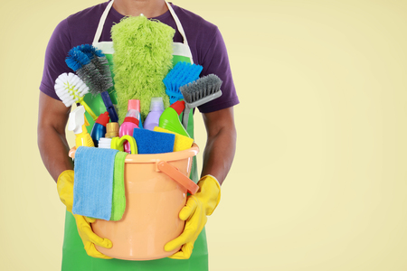 Portrait of man with cleaning equipment ready to clean house photo