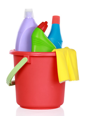 Plastic bucket with cleaning supplies isolated on white background photo