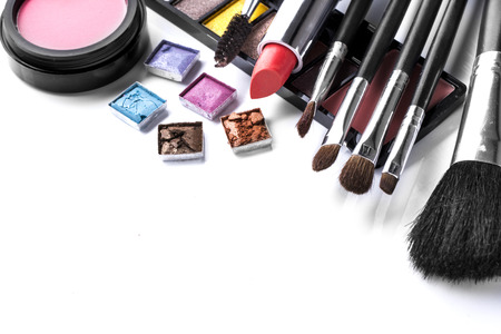 Various cosmetics and brush isolated over white background photo