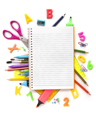 Notebook with stationary objects supplies in the background photo