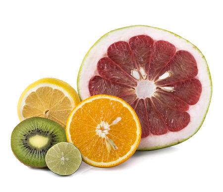 Assortment of exotic fresh fruits sliced isolated on white photo