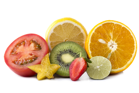 Assortment of exotic fresh fruits sliced isolated on white photo