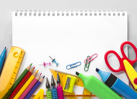 School supplies on white background ready for your design photo