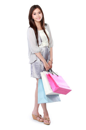 Beautiful woman with shopping bags over white  photo
