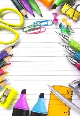 school things: Notebook with stationary objects supplies around it Stock Photo
