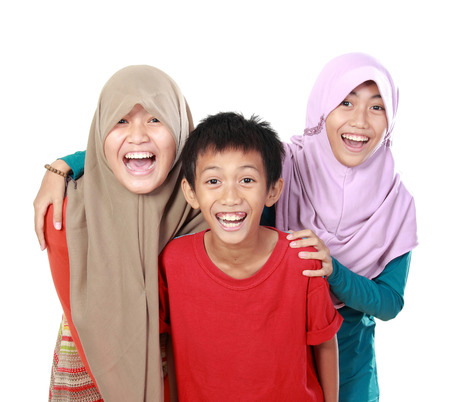 portrait of happy three kids smiling to the camera isolated on white background photo