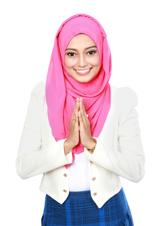 portrait of young attractive woman with traditional welcoming isolated over white background Stock Photo