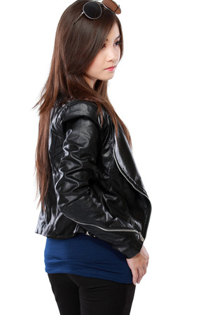 sexy asian woman: woman in black leather jacket posing isolated over white background Stock Photo