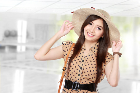young beautiful asian woman with hat smiling, retro styling
