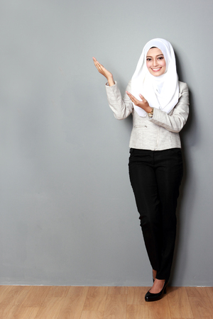 asian woman with scarf presenting copyspace photo