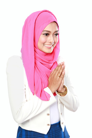 portrait of young attractive woman with traditional welcoming isolated over white background Imagens
