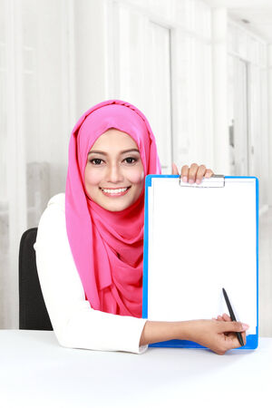 portrait of young asian woman showing blank document photo