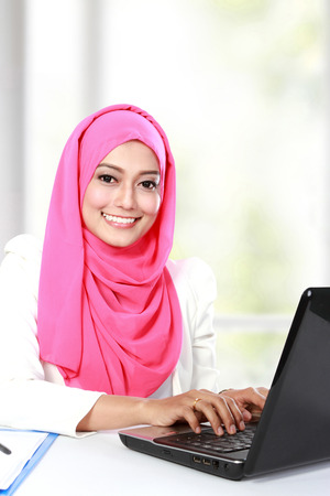 portrait of young asian woman working with laptop photo