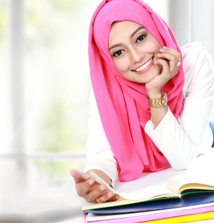 portrait of young asian woman studying photo