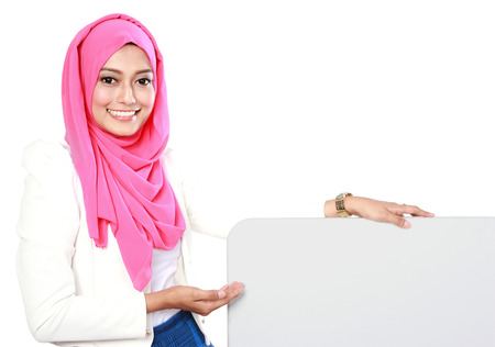 portrait of woman wearing scarf showing blank board Stock Photo