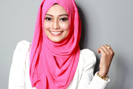 portrait of young attractive woman wearing scarf smiling to the camera Stock Photo