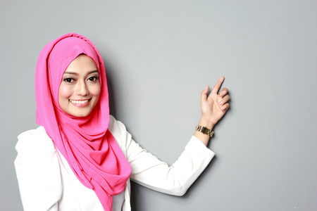 malay ethnicity: asian woman with scarf presenting copyspace