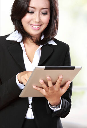 business transaction: portrait of beautiful businesswoman using tablet Stock Photo