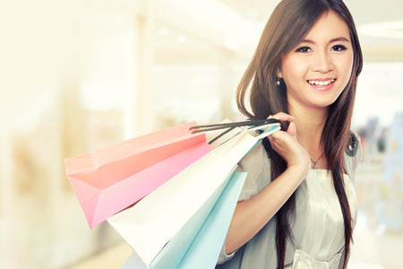 woman happy: Happy young woman going shopping in the mall