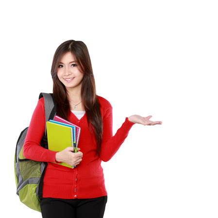 female student in red cardigan presenting blank area copy space - isolated on white background.