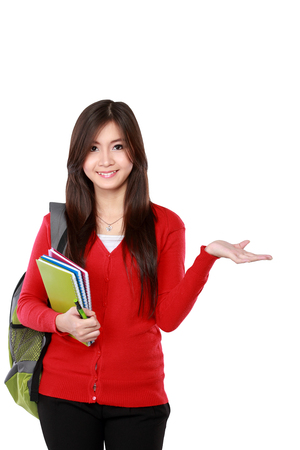 red cardigan: female student in red cardigan presenting blank area copy space - isolated on white background.