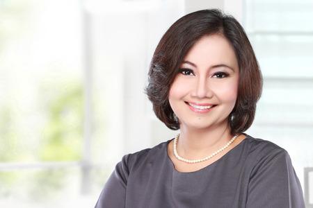 portrait of mature happy business women smiling 스톡 콘텐츠