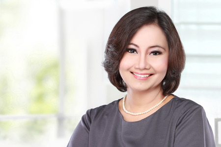 asian ladies: portrait of mature happy business women smiling Stock Photo