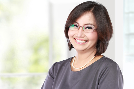 asian office lady: portrait of happy middle aged business women