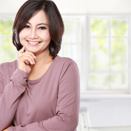 portrait of smiling casual middle aged woman photo