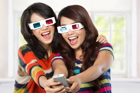 crazy girl: Teenager watching a 3D movie with retro 3D glasses