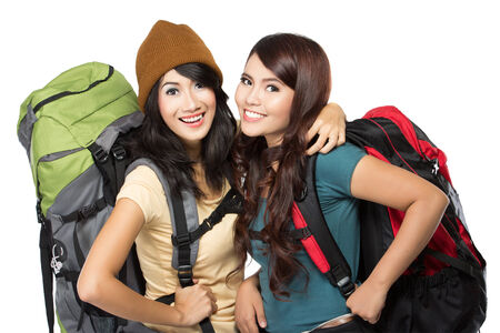 portrait of two happy young girl bring backpack and hug each other Stock Photo
