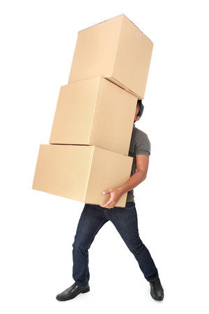 Man Holding some heavy Stack Of Cardboard Boxes On White Background Stock Photo
