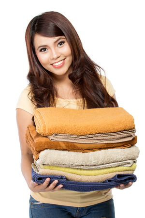 doing laundry: woman doing a housework holding laundry isolated over white background Stock Photo