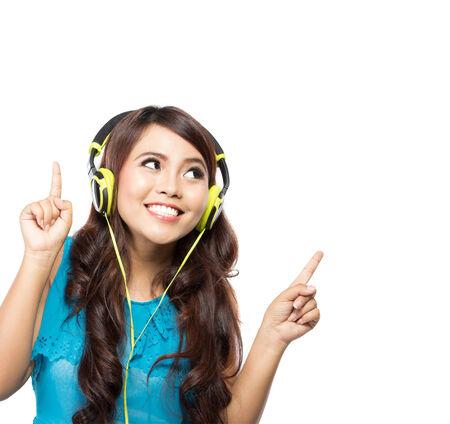 girl headphones: young asian girl listening music with headphones