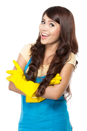 Portrait of young woman wearing glove ready to do some cleaning.