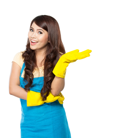 Portrait of young woman wearing cleaning glove presenting blank area